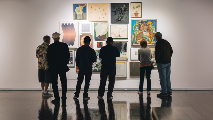 Photo of people viewing paintings