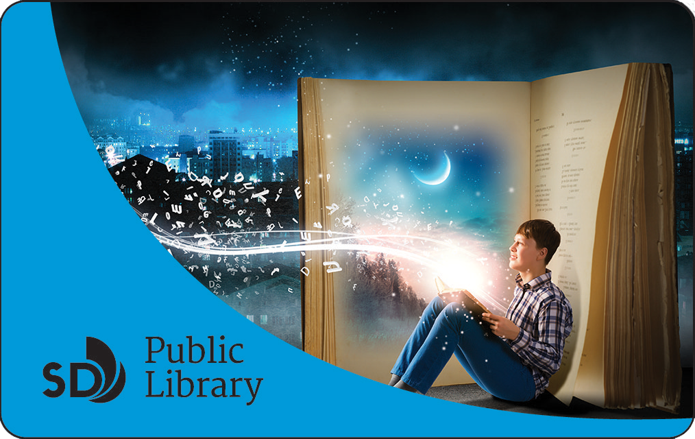 Photo of library card with boy reading book