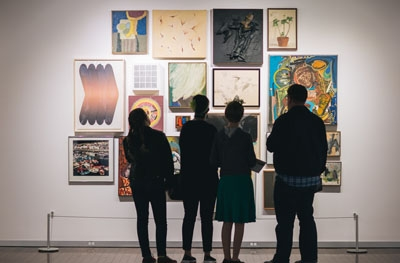 Library patrons viewing an exhibition in the Central Library Art Gallery.
