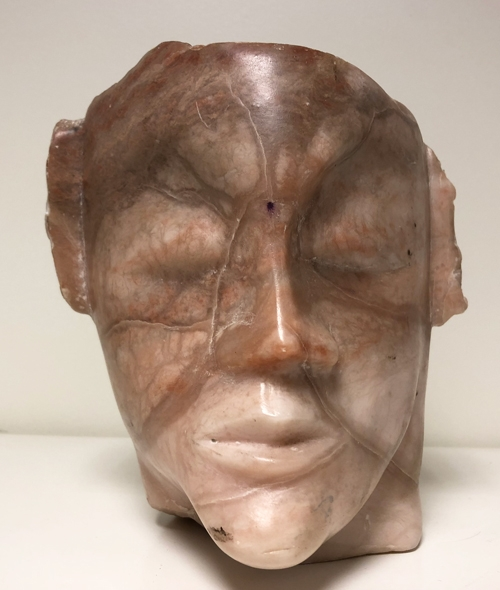 Carved marble head sculpture