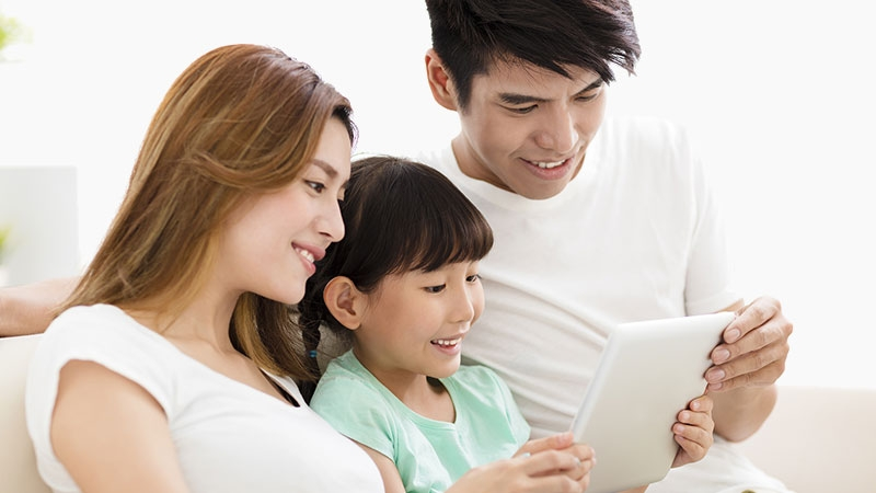 Asian family looking at tablet