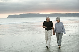Photo of Mature Couple Walking on the Beach