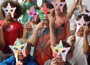 Kids with star masks.