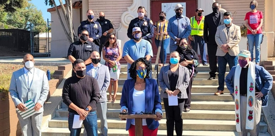 photo of Monica Montgomery and others wearing masks