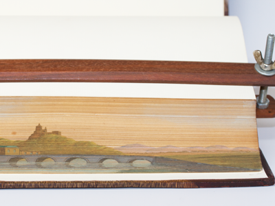 Image of a book with fore-edge painting of a bridge