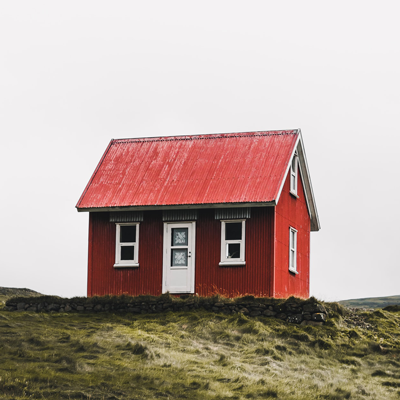 Image of a house with red paint