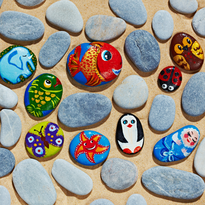 Image of painted rocks including fish and penguin
