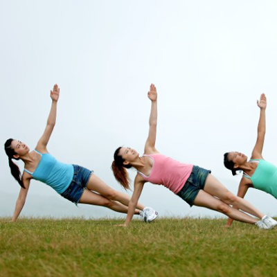 Image of three people performing yoga pose