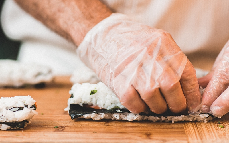 Chef rolling a sushi roll