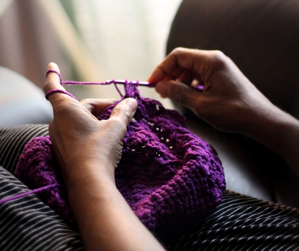Photo of a person knitting