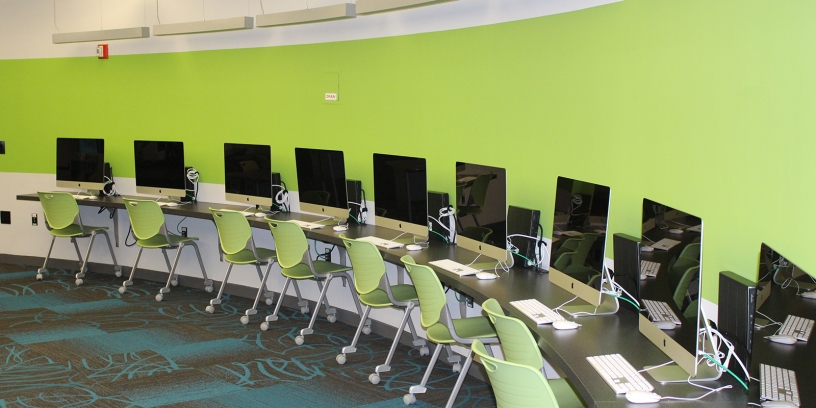 Photo of Apple iMac computers inside the Legler Benbough Teen IDEA Lab at the Valencia Park/Malcolm X Library.