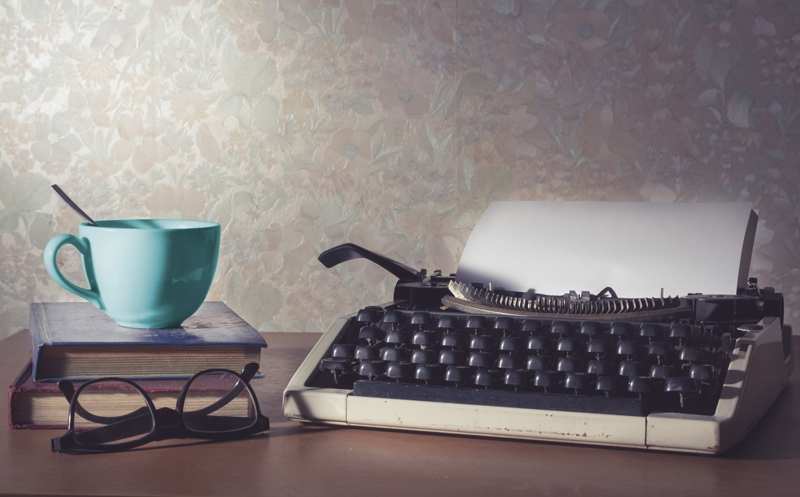 Tea cup and typewriter