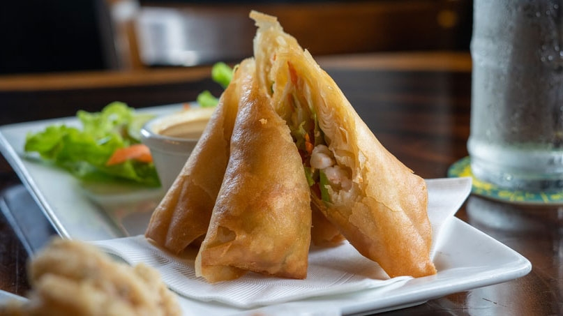 Image of cut lumpia on a plate