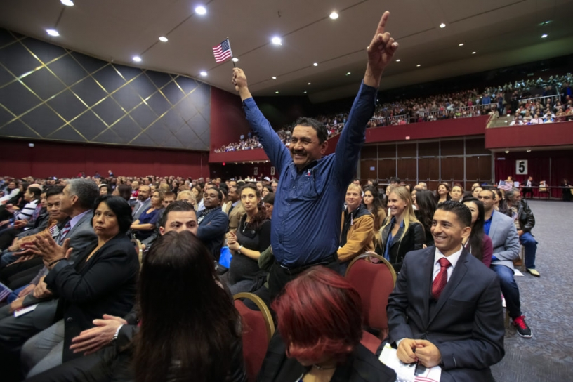 man celebrating during naturalization ceremony