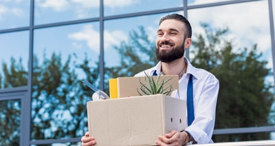 Man Quitting Work with Box