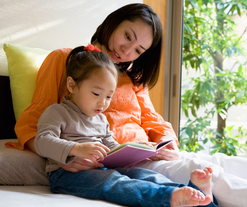 Mom reading with baby.