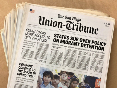 Image of a stack of the San Diego Union-Tribune newspaper