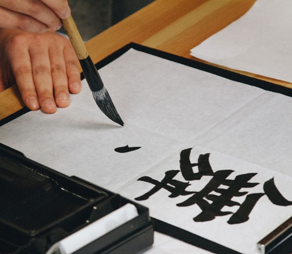 Photo of person writing calligraphy