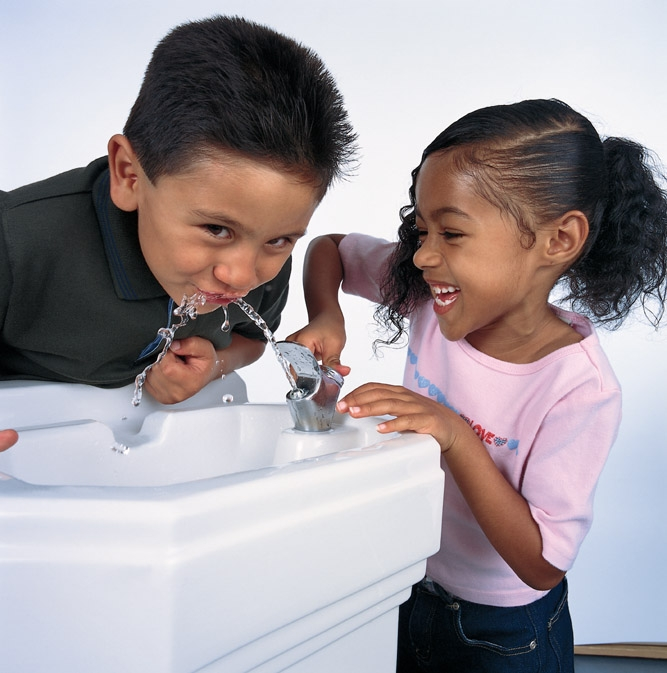 Two kids at a drinking fountain