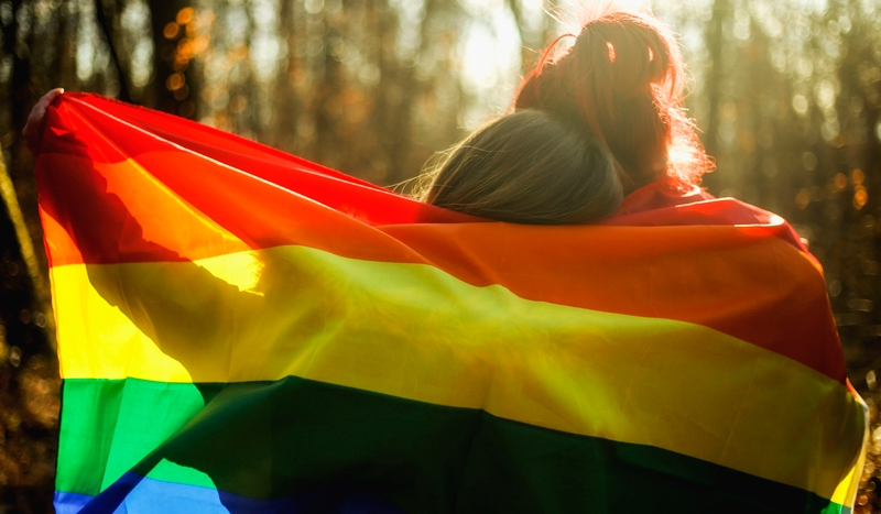 Rainbow flag wrapping around two people