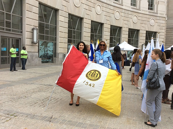 Photo of Student with The City of San Diego Flag at the Flag of Cities Parade