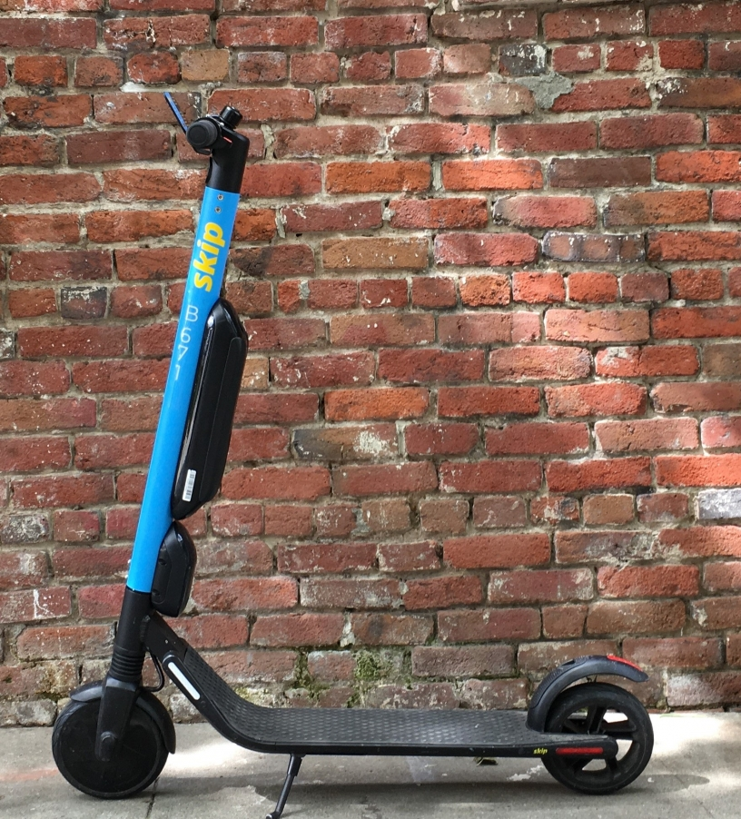 A picture of a blue and black Skip scooter.