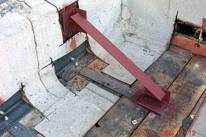 An example of roof parapet bracing and roof-to-wall anchor for URM buildings. Roof-to-wall anchors tie the roof diaphragm and the URM walls together minimizing risk of potential separation of the URM walls and roof during an earthquake.