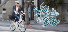 Better by Bike logo overlayed on a photo of a woman riding a bicycle on a city street