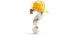 A question mark wearing a yellow hard hat.