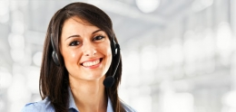 A smiling customer representative wearing a headset