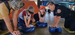 Photo of children learning CPR