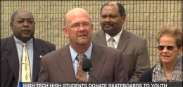 Photo of Councilmember Scott Sherman speaking at ceremony to donate skateboards