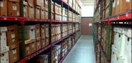 Photo of shelves containing boxes of records