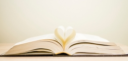 Photo of book with pages creating a heart.