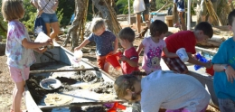 photo of children playing in the mud