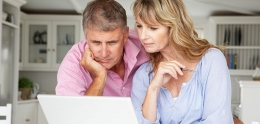 Adult couple looking at laptop
