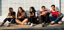 Group of social teenagers with smartphones