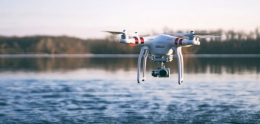 photo of drone flying over lake