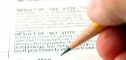Photo of person filling out ballot