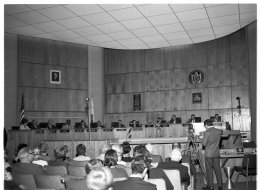 Photo of council chambers and elected council members