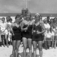 Three girls in black bathing suits
