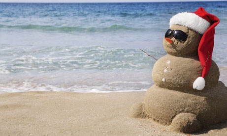 Photo of snow man made of sand at the beach