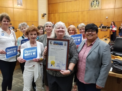 Dystonia Group Takes Picture in Council Chambers