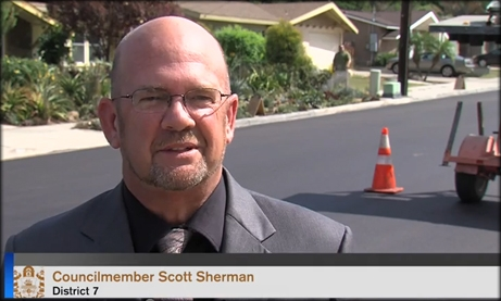Photo of Councilmember Scott Sherman on the newly resurfaced Allied Road