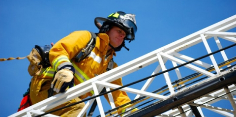 Photo of Fireman on Truck Ladder