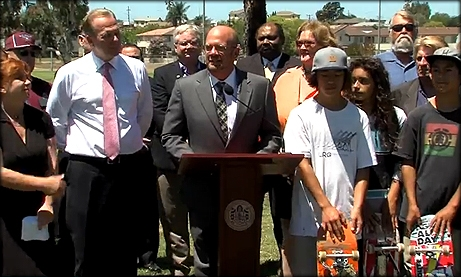 Photo of Councilmember Sherman speaking at the check presentation for the Linda Vista Skate Park