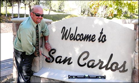 Photo of Councilmember Sherman fixing the San Carlos Sign