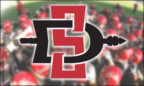 Photo of SDSU Aztecs Logo and Football Players in the Background