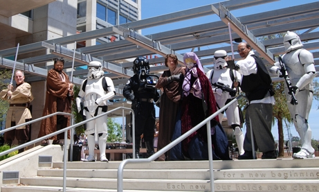 Star Wars characters posing in front of the library's steps.