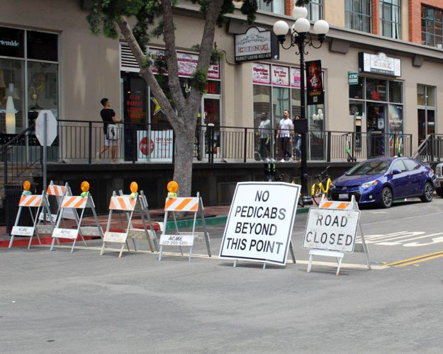 Traffic barricades indicating a closed street in downtown San Diego